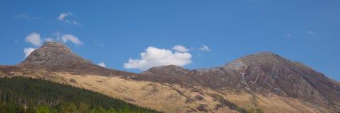 View to mountains surrounding Glencoe Village Glen Coe Scotland UK panorama Royalty Free Stock Photo