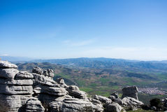 A view to mountains and villages from observation deck. A view to mountains and villages from observation deck at natural park El Torcal in Spain Royalty Free Stock Photography