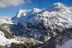View to the Murren village from the cable car gondola on the way to Schilthorn in Murren, Switzerland. Royalty Free Stock Image