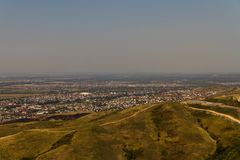 View over city outskirts to flat plain. Royalty Free Stock Photography