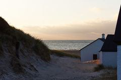 View to the Northsea from the dunes in Stenbjerg, Denmark. Houses in the dunes in Stenbjerg at the North sea coast in Denmark Stock Images