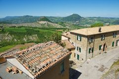 View to the old buildings of San Leo medieval town in San Leo, Italy. Stock Photos