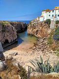 View to old houses on cliff near ocean beach in Peniche. Portugal Royalty Free Stock Images