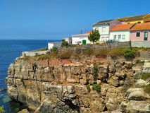 View to old houses on cliff near the ocean in Peniche Stock Image