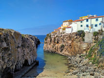 View to old houses on cliff near the ocean in Peniche Stock Photo