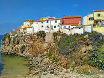 View to old houses on cliff near the ocean in Peniche Stock Photography