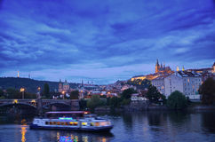 View to old Prague bridge, Czech Republic. Beautiful October evening in old Prague - motorship on the Visla river Royalty Free Stock Photography