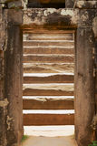 View to the old staircase in the Bakong temple in Siem Reap, Cambodia. Stock Photos