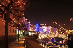 View to one of Three bridges, with Ljubljanica river and decorated trees for Christmas and New Years holiday Stock Images
