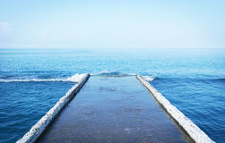View to an outdoor seascape from a breakwater Royalty Free Stock Images