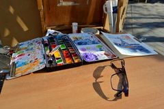 View to a painter table in Montmartre, Paris. Royalty Free Stock Photo