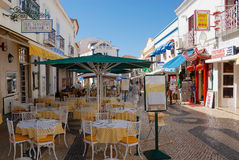 View to the pedestrian street with restaurants in Lagos, Portugal. Stock Photography