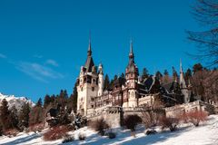 View to the Peles Castle during the winter season. Sunny day and clear sky. Romania, Sinaia. Royalty Free Stock Images