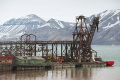 View to the pier of the abandoned Russian arctic settlement Pyramiden, Norway. Royalty Free Stock Photo