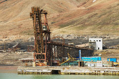 View to the pier of abandoned Russian arctic settlement Pyramiden, Norway. Stock Photo