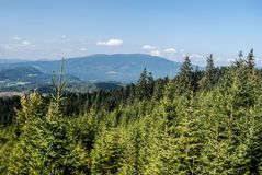 Pilsko hill from hiking trail to Babia hora hill in Oravske Beskydy mountains. View to Pilsko hill with lower hills around from Staviny view tower bellow Babia stock photos