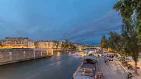View to the Pont De La Tournelle on the River Seine day to night timelapse with embankment. View to the Pont De La Tournelle on the River Seine day to night stock footage