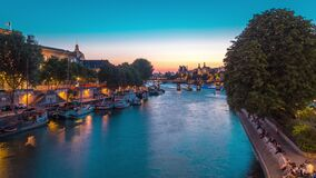 View to Pont des Arts in Paris after sunset day to night timelapse, France