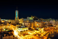 View to Portomaso tower over Spinola bay. MALTA - JANUARY 20 2015: View to Portomaso tower over Spinola bay shore with famous touristic restaurants at St Julian Stock Image