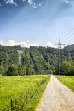 View to power plant at Kochelsee Royalty Free Stock Images