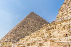 The Pyramid of Cheops in Egypt. View to the Pyramid of Cheops from pyramid of queen. Giza plateau, Egypt stock images