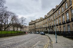 A view to Randolph Cresent - typical cobblestone street in Edinb Stock Images
