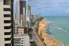 A view to the Recife city beach. Recife, Pernambuco, Brazil, 2009. A view to the city beach with lots of Brazilian people sunbathing and swimming, and umbrellas Stock Photography