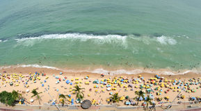 A view to the Recife city beach. RECIFE, PERNAMBUCO, BRAZIL, SEPTEMBER 1, 2009. A view to the city beach with lots of Brazilian people sunbathing and swimming Stock Photos