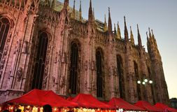 View to red roof Christmas tents and Duomo of Milan brightly illuminated. Royalty Free Stock Photography