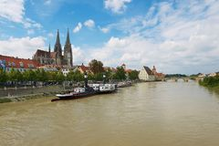 View to Regensburg cathedral and historical buildings with Danube river at the foreground in Regensburg, Germany. REGENSBURG, GERMANY - SEPTEMBER 03, 2010: View Royalty Free Stock Photography