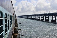 View to a road bridge from a train on the Pamban Bridge Stock Images