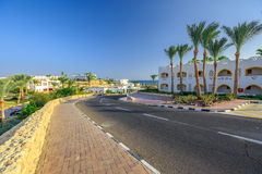 The view to road and palm trees near the hotels Stock Photos