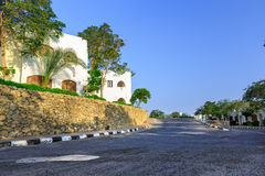 The view to road and palm trees near the hotels Royalty Free Stock Photos