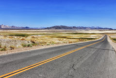 View to the road at Shoshone, USA. View to the road, colorful field and mountains at Shoshone area, California, USA Stock Photography