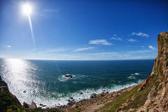 View to the rocks and ocean. View from the cliff to the rocks and ocean stock photo