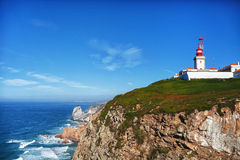 View to the rocks and ocean. View to the rocks with a lighthouse and ocean royalty free stock photos