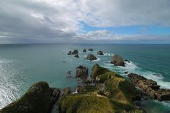 A view to rocks in the sea at Nugget point Lighthouse stock photos