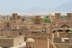 View to the roofs of the old brick buildings with badgirs (wind catching towers) in Yazd, Iran. Stock Photo