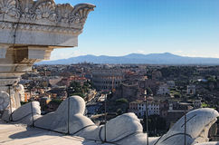View to rooftops of Rome skyline from the Monument of Vittorio Emanuele at Piazza Venezia. Colosseum in the background royalty free stock photo