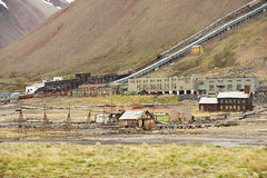View to the ruined coal mine in the abandoned Russian arctic settlement Pyramiden, Norway. Stock Photo