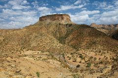 View to the rural surroundings and the hill, on top of which the famous 6-th century Ethiopian Debre Damo Monastery is located in Stock Photography