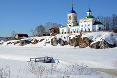View to Russian Orthodox `St. George` Church  in Sloboda village. View to Russian Orthodox `St. George` Church was founded in 1806 year on the shore of frozen Stock Photos