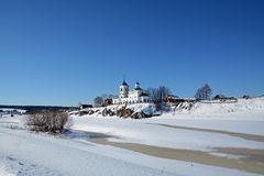View to Russian Orthodox `St. George` Church  in Sloboda village. View to Russian Orthodox `St. George` Church was founded in 1806 year on the shore of frozen Royalty Free Stock Image