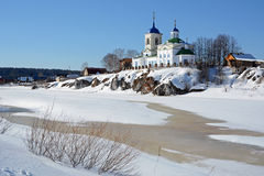 View to Russian Orthodox `St. George` Church  in Sloboda village. View to Russian Orthodox `St. George` Church was founded in 1806 year on the shore of frozen Royalty Free Stock Photography