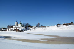 View to Russian Orthodox `St. George` Church  in Sloboda village. View to Russian Orthodox `St. George` Church was founded in 1806 year on the shore of frozen Royalty Free Stock Photos