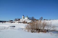 View to Russian Orthodox `St. George` Church. View to Russian Orthodox `St. George` Church was founded in 1806 year on the shore of frozen Chusovaya river in Royalty Free Stock Photos