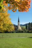 Saint sixtus church schliersee, autumnal maple trees. View to saint sixtus church schliersee, autumnal maple trees and green meadow royalty free stock photography