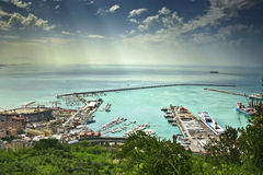The view to Salerno port in Italy. Port of Salerno, Italy, lying under sun rays Stock Photography