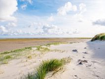 View to sand flats of Wadden Sea at low tide from beach of nature reserve Boschplaat on island Terschelling, Netherlands stock photo