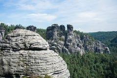 A view to sandstone mountains from Bastei Bridge at Bastei, Kurort Rathen Royalty Free Stock Photography